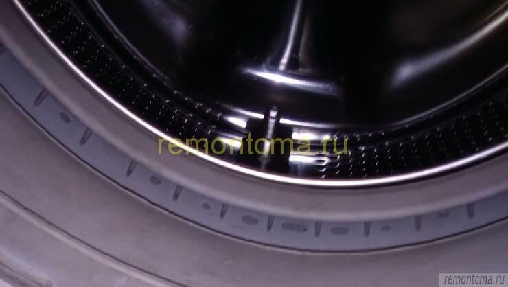 Край барабана стиральной машины
